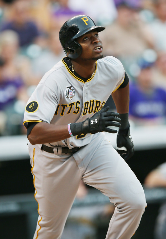 . Pittsburgh Pirates\' Gregory Polanco follows the flight of his solo home run against the Colorado Rockies in the eighth inning of the Pirates\' 7-5 victory in a baseball game in Denver, Sunday, July 27, 2014. (AP Photo/David Zalubowski)