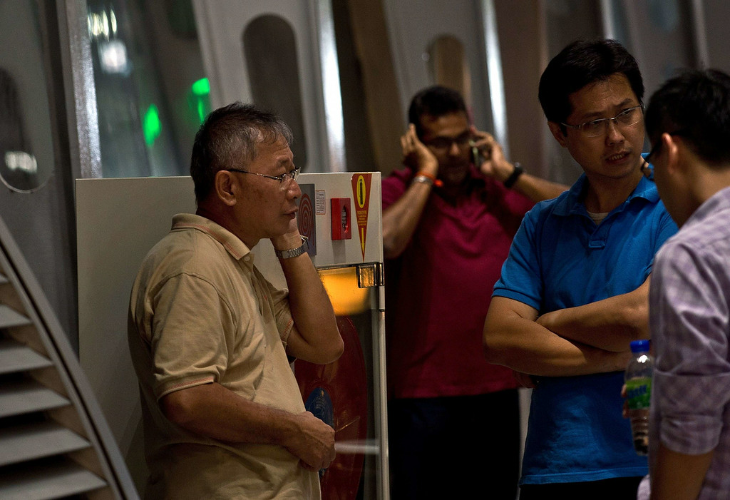""". Relatives of passengers onboard Malaysia Airlines flight MH17 from Amsterdam wait for information outside the family holding area at the Kuala Lumpur International Airport in Sepang on July 18, 2014. Malaysia Airlines said on July 17 that it had \""""lost contact\"""" with one of its passenger planes carrying 295 people over eastern Ukraine, amid speculation it had been shot down. Pro-Russian rebels fighting central Kiev authorities claimed that the Malaysian airline that crashed in Ukraine had been shot down by a Ukrainian jet. The head of Ukraine\'s air traffic control agency said Thursday that the crew of the Malaysia Airlines jet that crashed in the separatist east had reported no problems during flight.   AFP PHOTO/ MANAN  VATSYAYANA/AFP/Getty Images"""