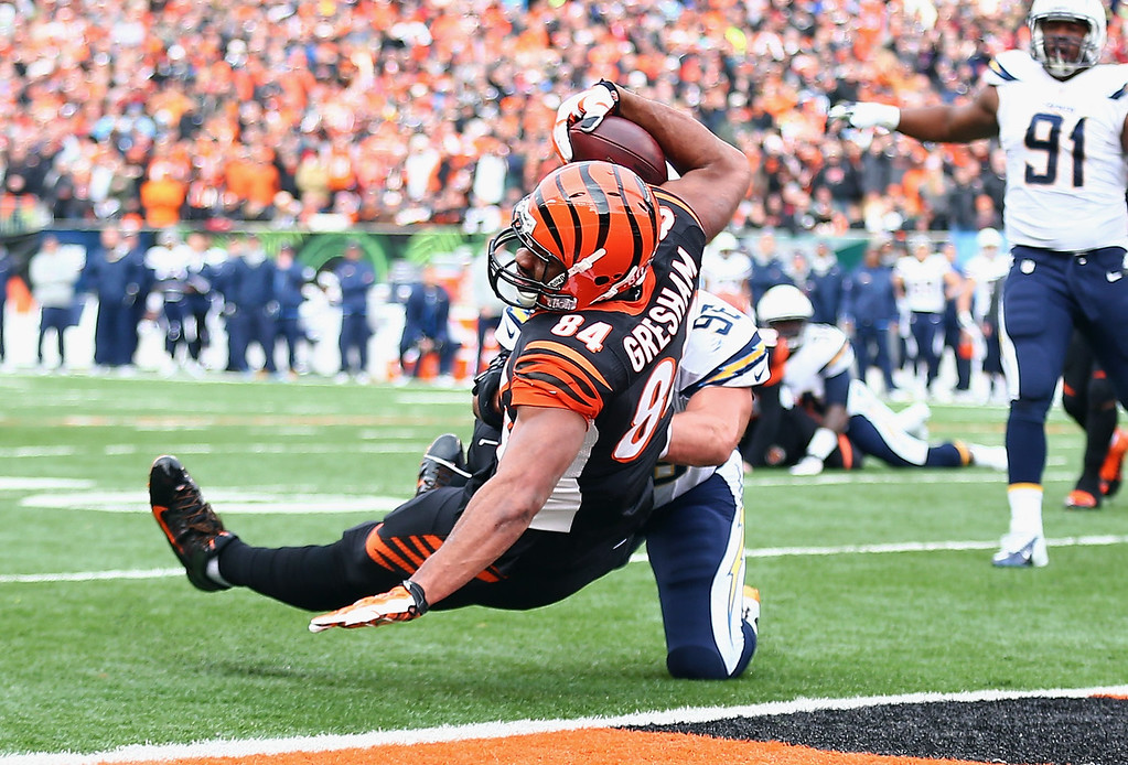 . Jermaine Gresham #84 of the Cincinnati Bengals catches a touchdown pass the NFL wild card playoffs game against the San Diego Chargers at Paul Brown Stadium on January 5, 2014 in Cincinnati, Ohio.  (Photo by Andy Lyons/Getty Images)