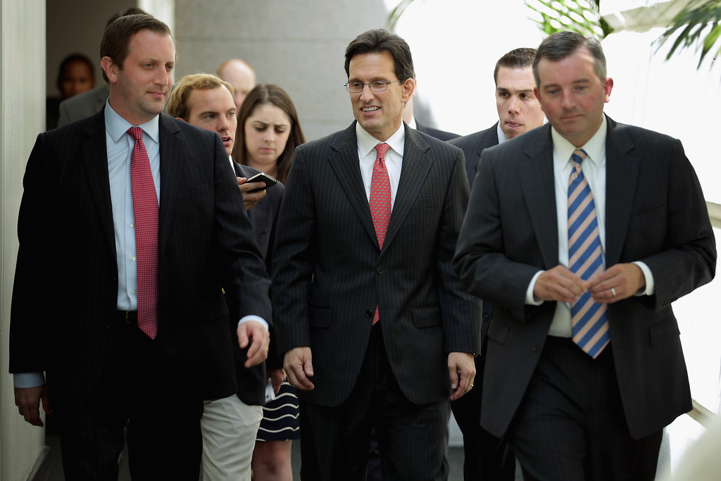. House Majority Leader Eric Cantor (R-VA) (C) arrives for a Republican Conference meeting at the U.S. Capitol September 30, 2013 in Washington, DC. If Boehner and the House Republicans do not find common ground with President Obama and Senate Democrats on the federal budget then at midnight large sections of the government will close, hundreds of thousands of workers would be furloughed without pay, and millions more would be asked to work for no pay.  (Photo by Chip Somodevilla/Getty Images)