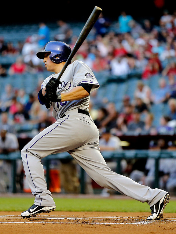 . Colorado Rockies\'  Jordan Pacheco connects for a base hit against the Arizona Diamondbacks during the first inning of a baseball game, Friday, April 26, 2013, in Phoenix. (AP Photo/Matt York)