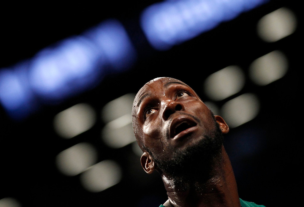 . Boston Celtics forward Kevin Garnett watches a free throw attempt by the Brooklyn Nets in the third quarter of their NBA basketball game in New York, December 25, 2012.    REUTERS/Adam Hunger