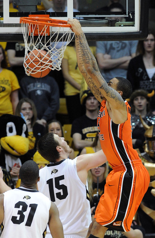 . Eric Moreland of OSU dunks on Shane Harris-Tunks during the second half of the March 9, 2013 game in Boulder.    (Cliff Grassmick/Boulder Daily Camera)