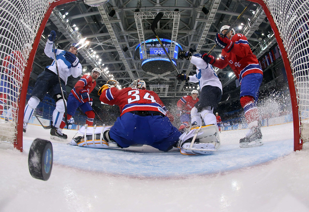 . Finland\'s Olli Maatta (2nd R) scores a goal during the Men\'s Ice Hockey Group B match Norway vs Finland at the Shayba Arena during the Sochi Winter Olympics on February 14, 2014. Finland won 1-6. Martin Rose/AFP/Getty Images