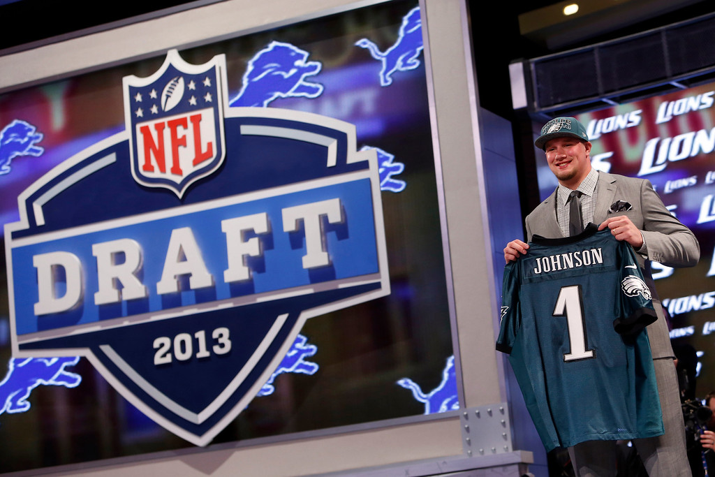 . Tackle Lane Johnson from Oklahoma holds up the team jersey after being selected fourth overall by the Philadelphia Eagles in the first round of the NFL football draft, Thursday, April 25, 2013 at Radio City Music Hall in New York.  (AP Photo/Jason DeCrow)