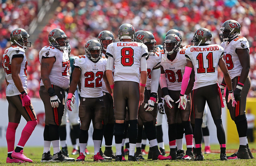 . Mike Glennon #8 of the Tampa Bay Buccaneers calls a play in the huddle during a game against the Philadelphia Eagles at Raymond James Stadium on October 13, 2013 in Tampa, Florida.  (Photo by Mike Ehrmann/Getty Images)