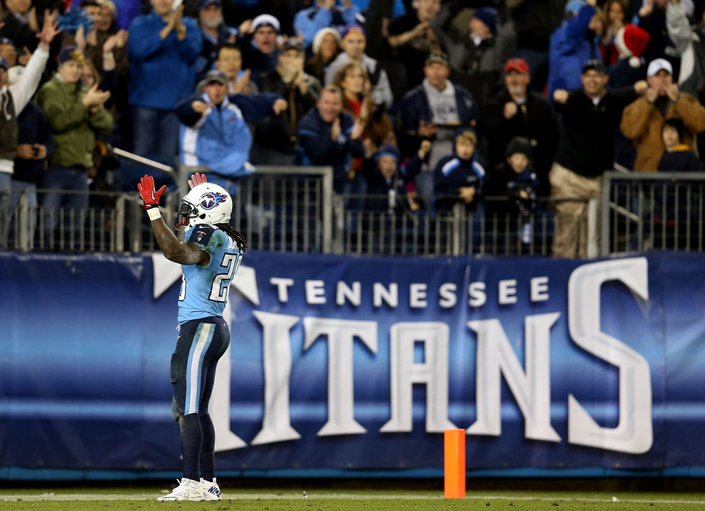. NASHVILLE, TN - DECEMBER 17:  Running back Chris Johnson #28 of the Tennessee Titans celebrates after scoring a touchdown in the second quarter against the New York Jets at LP Field on December 17, 2012 in Nashville, Tennessee.  (Photo by Andy Lyons/Getty Images)
