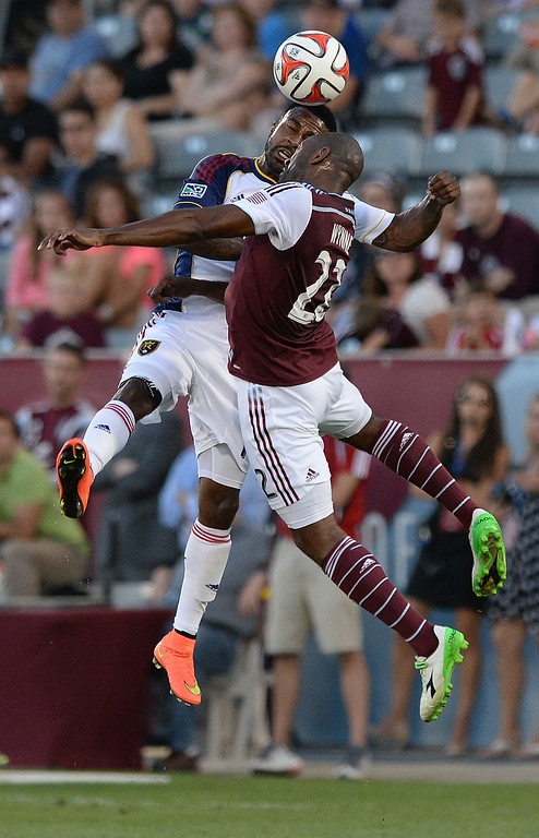 . COMMERCE CITY, CO - AUGUST 1: Salt Lake forward Robbie Findley, left, headed the ball past Rapids defender Narvell Wynne, right, in the first half. The Colorado Rapids hosted Real Salt Lake at Dick\'s Sporting Goods Park Saturday night, August 1, 2014.  Photo by Karl Gehring/The Denver Post