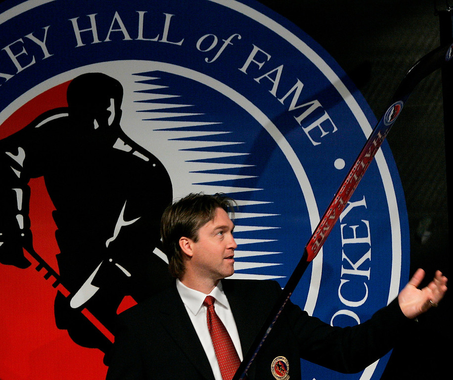 . Hockey Hall of Fame inductee Patrick Roy plays around with a goalie stick and puck on the stage after accepting his inductee ring on Monday, Nov. 13, 2006 in Toronto at the Hockey Hall of Fame. Roy played his career with the Montreal Canadians and the Colorado Avalanche. (Nathan Denette/Canadian Press)