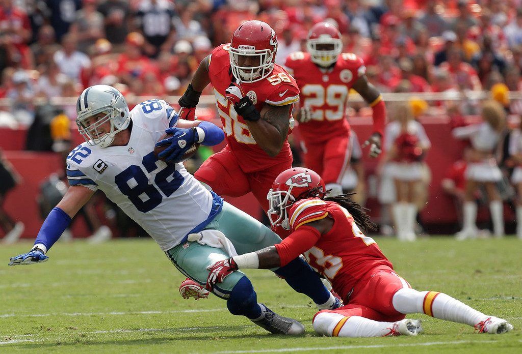 . Dallas Cowboys tight end Jason Witten (82) is tackled after a catch by Kansas City Chiefs free safety Kendrick Lewis (23) during the first half of an NFL football game at Arrowhead Stadium in Kansas City, Mo., Sunday, Sept. 15, 2013. (AP Photo/Charlie Riedel)