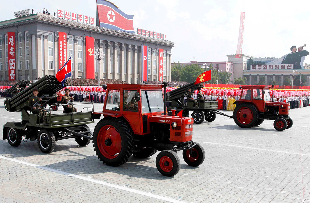 . Tractors pull artillery through Kim Il Sung Square during a military parade to mark the 65th anniversary of the country\'s founding in Pyongyang, North Korea, Monday, Sept. 9, 2013. (AP Photo/Kim Kwang Hyon)