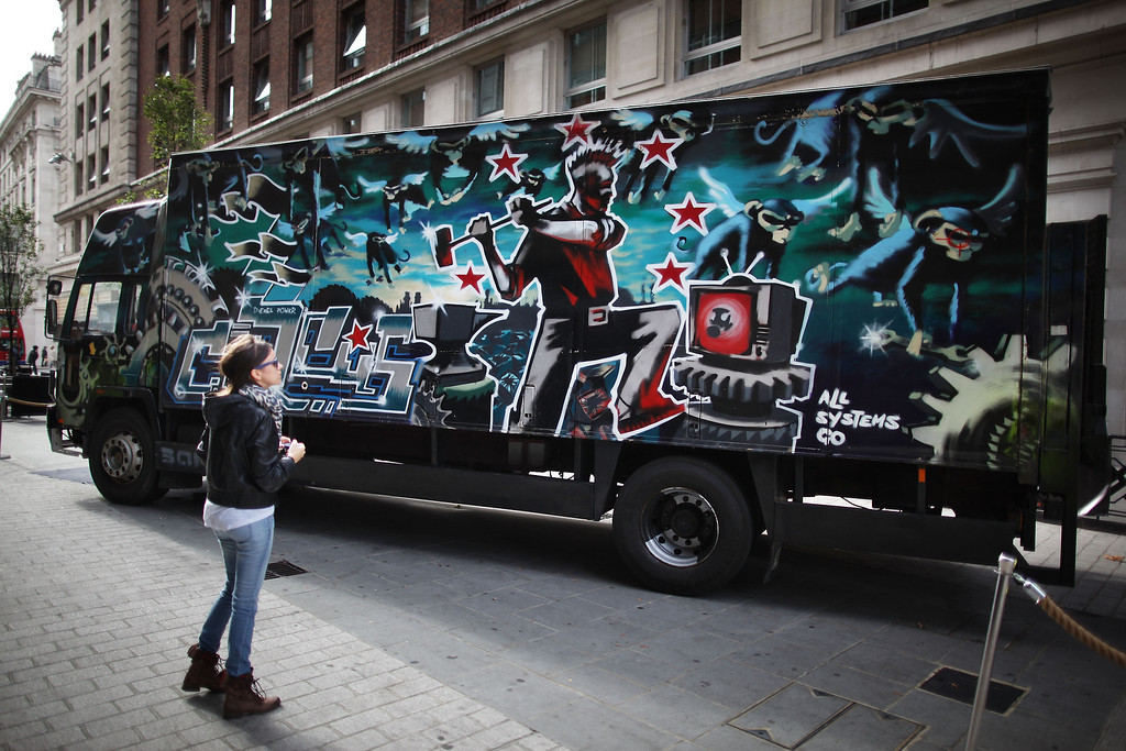 . A Banksy decorated truck entitled \'Laugh now but one day we\'ll be in charge\' is displayed for sale on October 6, 2011 in London, England. The Volvo FL6 lorry was decorated by British street artist Banksy for a millennium party for Turbozone, pyrotechnic touring circus. It will be offered for auction in London this month.  (Photo by Peter Macdiarmid/Getty Images)
