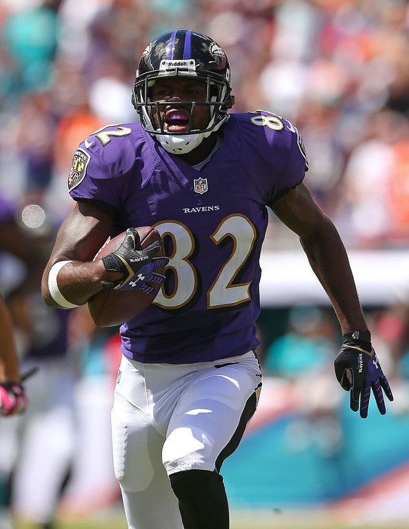 . Torrey Smith #82 of the Baltimore Ravens runs after a catch during a game against the Miami Dolphins at Sun Life Stadium on October 6, 2013 in Miami Gardens, Florida.  (Photo by Mike Ehrmann/Getty Images)