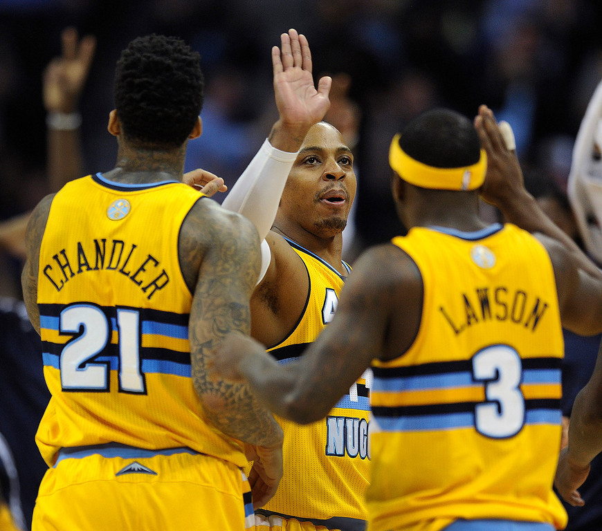 . Denver guard Randy Foye (4) accepted high-fives from Wilson Chandler and Ty Lawson in the second half.   Photo By Karl Gehring/The Denver Post