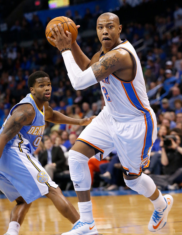 . Oklahoma City Thunder forward Caron Butler drives past Denver Nuggets guard Aaron Brooks (0) in the fourth quarter of an NBA basketball game in Oklahoma City, Monday, March 24, 2014. Oklahoma City won 117-96. (AP Photo/Sue Ogrocki)