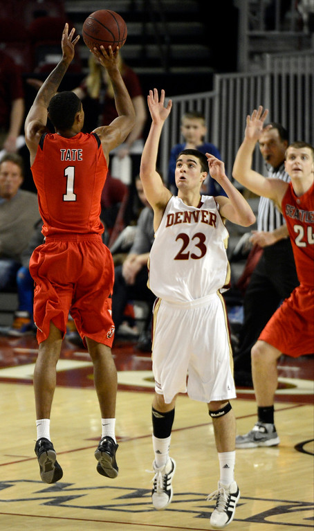 . DENVER, CO. - FEBRUARY 07: Allen Tate (1) of the Seattle Redhawks takes a shot over Brett Olson (23) of the Denver Pioneers during the second half February 7, 2013 at Magness Arena.The Denver Pioneers defeated the Seattle Redhawks 72-55. (Photo By John Leyba/The Denver Post)