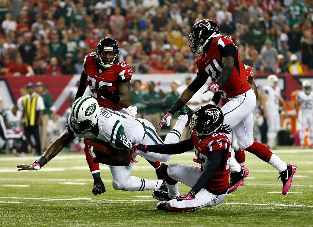 . Tight end Jeff Cumberland #87 of the New York Jets is tackled by cornerback Asante Samuel #22 of the Atlanta Falcons during their game at the Georgia Dome on October 7, 2013 in Atlanta, Georgia.  (Photo by Kevin C. Cox/Getty Images)