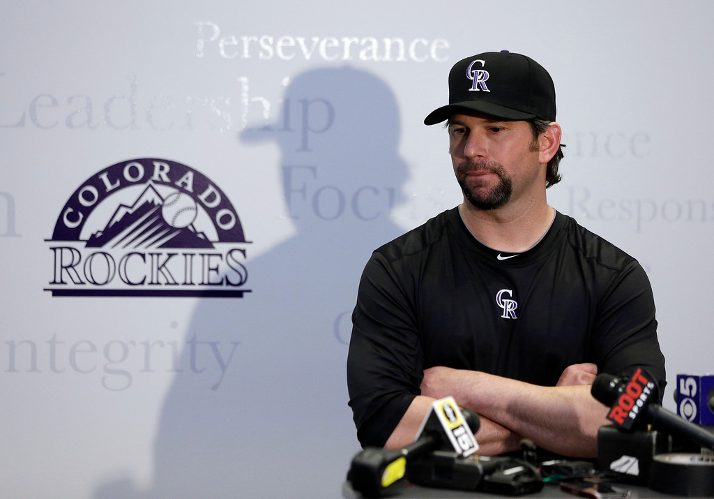 . Colorado Rockies\' Todd Helton responds to a question during a news conference following a spring training baseball workout on Sunday, Feb. 17, 2013, in Scottsdale, Ariz. (AP Photo/Darron Cummings)