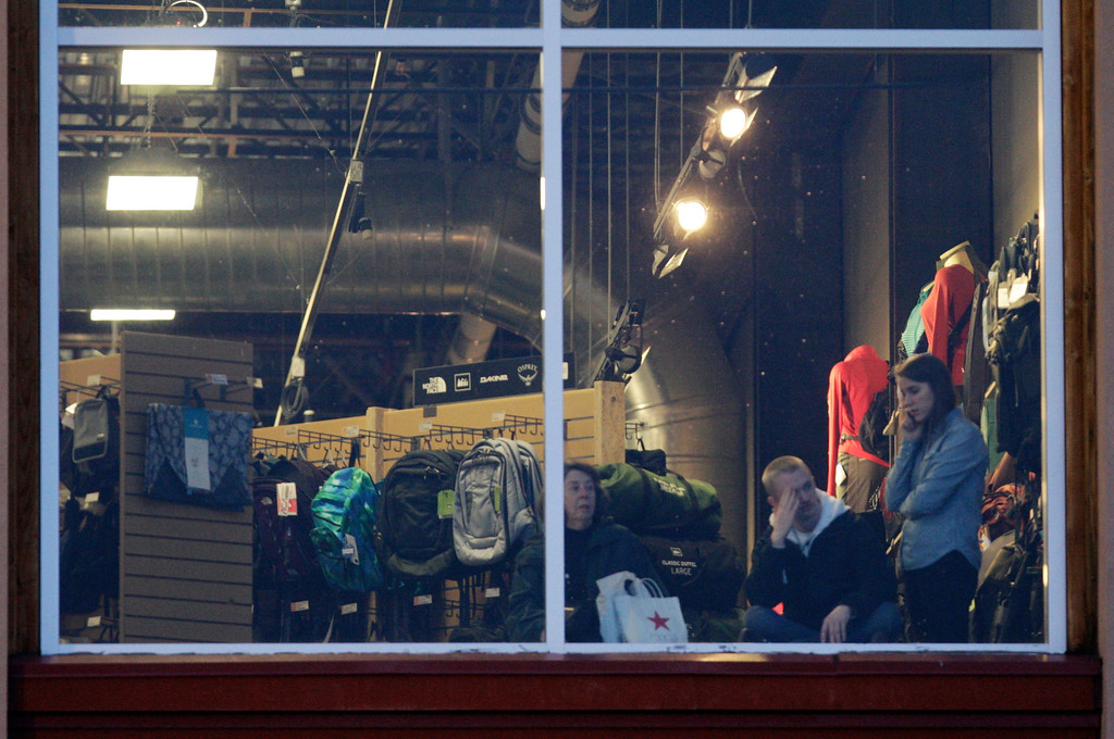 . Mall workers and shoppers wait to be cleared to leave REI at Clackamas Town Center in Portland, Ore., where a shooting occurred Tuesday, Dec. 11, 2012. A gunman opened fire at the suburban Portland shopping mall Tuesday, killing two people and wounding another as people were doing their Christmas shopping, authorities said. (AP Photo/The Oregonian, Thomas Boyd)