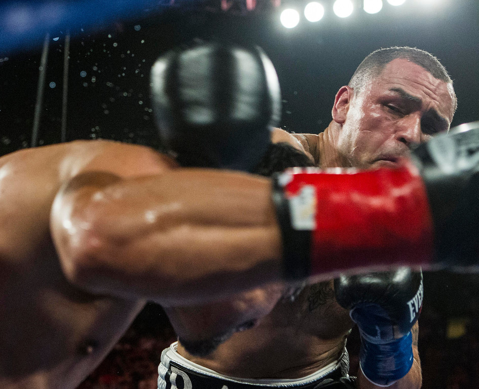 . Mike Alvarado, right, lands a punch against Juan Manuel Márquez, right, of Mexico in the fourth round of a WBO welterweight title boxing match at the Forum in Inglewood, Calif., Saturday, May 17, 2014. Márquez won the title.  (AP Photo/Ringo H.W. Chiu)