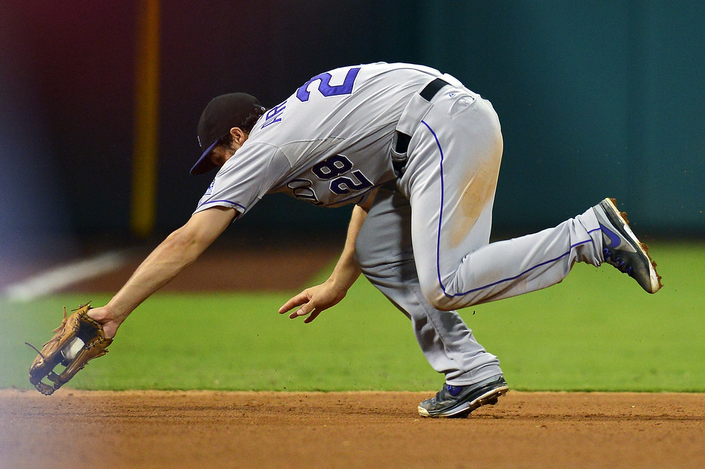 . Nolan Arenado #28 of the Colorado Rockies makes a tough catch on a ground ball in the seventh inning against the Philadelphia Phillies at Citizens Bank Park on August 20, 2013 in Philadelphia, Pennsylvania. The Rockies won 5-3. (Photo by Drew Hallowell/Getty Images)