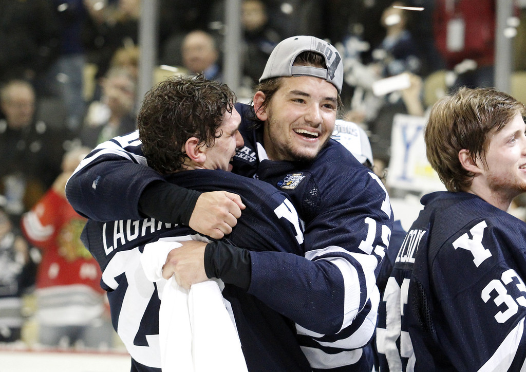 . PITTSBURGH, PA - APRIL 13:  Anthony Day #19 of the Yale Bulldogs celebrates after defeating the Quinnipiac Bobcats in the Men\'s Ice Hockey National Championship game at Consol Energy Center on April 13, 2013 in Pittsburgh, Pennsylvania.  (Photo by Justin K. Aller/Getty Images)