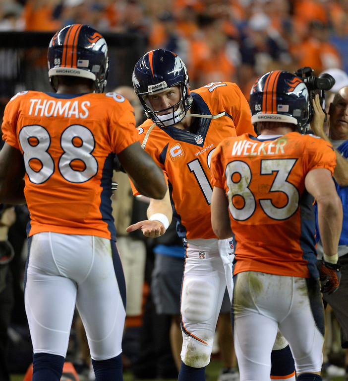 . DENVER, CO - SEPTEMBER 05: Denver Broncos quarterback Peyton Manning (18) greets  wide receiver Demaryius Thomas (88) after Thomas caught a touchdown pass during the fourth quarter. Denver Broncos Baltimore Ravens September 5, 2013 at Sports Authority at Mile High. (Photo by Joe Amon/The Denver Post)