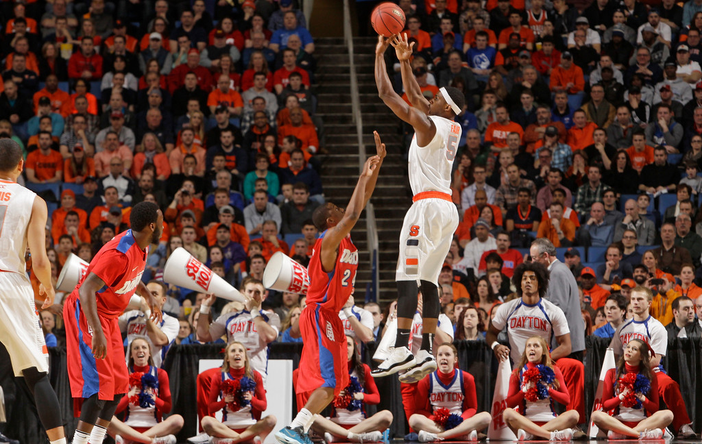 . Syracuse\'s C.J. Fair (5) shoots over Dayton\'s Jordan Sibert (24) during the first half of a third-round game in the NCAA men\'s college basketball tournament in Buffalo, N.Y., Saturday, March 22, 2014. (AP Photo/Bill Wippert)