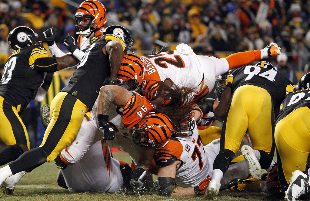 . Gio Bernard #25 of the Cincinnati Bengals dives for a 1 yard touchdown against the Pittsburgh Steelers during the game on December 15, 2013 at Heinz Field in Pittsburgh, Pennsylvania.  (Photo by Justin K. Aller/Getty Images)