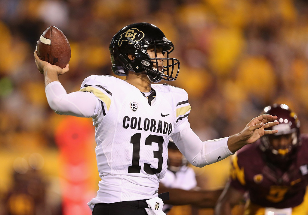 . TEMPE, AZ - OCTOBER 12:  Quarterback Sefo Liufau #13 of the Colorado Buffaloes throws a pass during the college football game against the Arizona State Sun Devils at Sun Devil Stadium on October 12, 2013 in Tempe, Arizona.  (Photo by Christian Petersen/Getty Images)