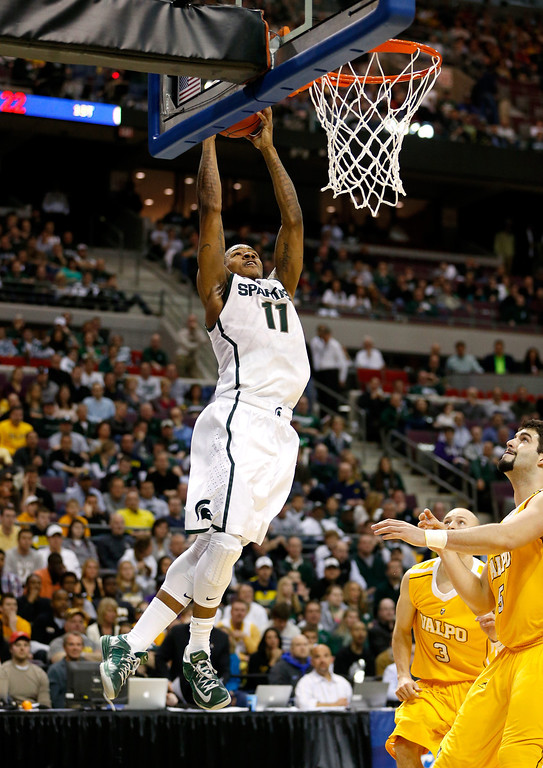 . Keith Appling #11 of the Michigan State Spartans attempts a dunk in the first half against the Valparaiso Crusaders during the second round of the 2013 NCAA Men\'s Basketball Tournament at at The Palace of Auburn Hills on March 21, 2013 in Auburn Hills, Michigan.  (Photo by Gregory Shamus/Getty Images)