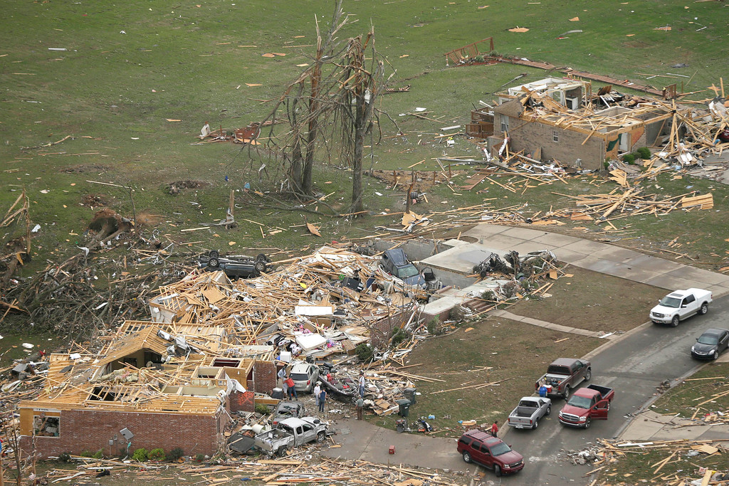 . Houses are destroyed in Mayflower, Ark., Monday, April 28, 2014, after a tornado struck the town late Sunday. (AP Photo/Danny Johnston)