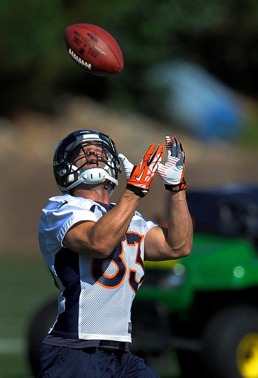 . Denver Broncos wide receiver Wes Welker (83) catches a pass during practice September 9, 2013 at Dove Valley. (Photo by John Leyba/The Denver Post)