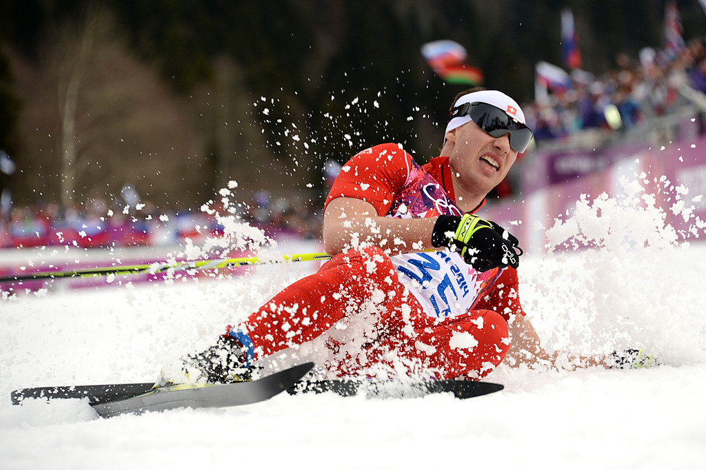 . Gold medalist Switzerland\'s Dario Cologna (35) crosses the finish line in the Men\'s Cross-Country Skiing 15km Classic at the Laura Cross-Country Ski and Biathlon Center during the Sochi Winter Olympics on February 14, 2014 in Rosa Khutor near Sochi.   AFP PHOTO / KIRILL KUDRYAVTSEV/AFP/Getty Images