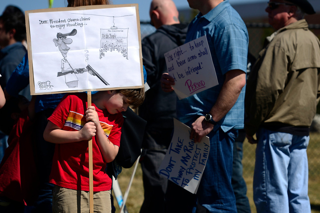 . DENVER, CO - APRIL 3: Shane Picker, 6, holds a sign protesting Barack Obama during a speech by the president during a speech at the Denver Police Academy. Both sides gathered outside of the complex to share their respective views. (Photo by AAron Ontiveroz/The Denver Post)