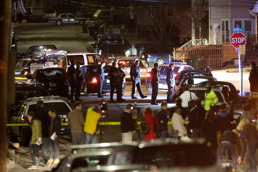 . Police work a crime scene Friday, April 19, 2013, in Watertown, Mass. (AP Photo/Matt Rourke)