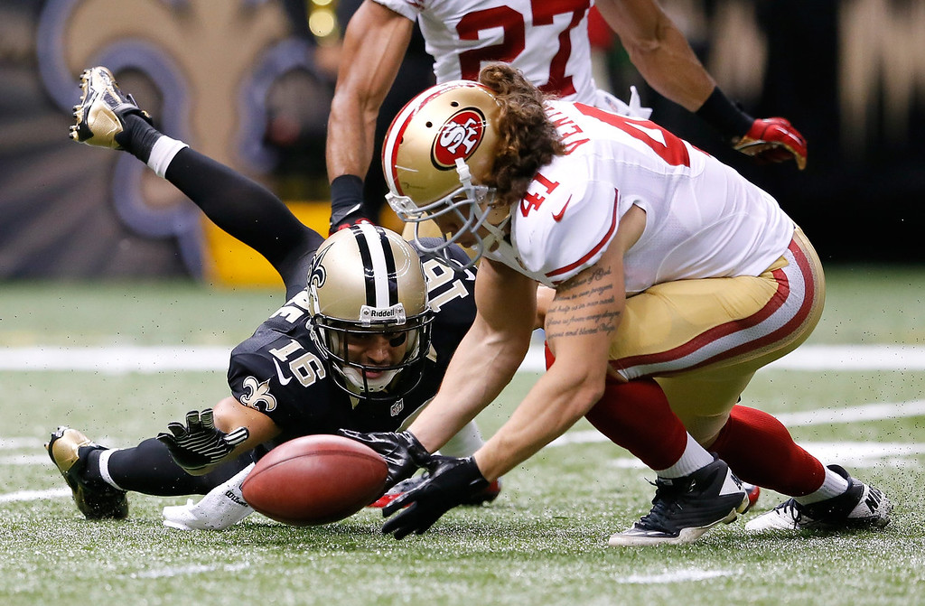 . Raymond Ventrone #41 of the San Francisco 49ers scoops up a fumble by Lance Moore #16 of the New Orleans Saints at Mercedes-Benz Superdome on November 17, 2013 in New Orleans, Louisiana.  (Photo by Kevin C. Cox/Getty Images)