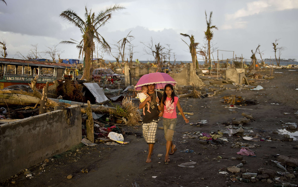 . A family of typhoon survivors walks among the rubble of destroyed homes in Tacloban on November 21, 2013.    AFP PHOTO / ODD  ANDERSEN/AFP/Getty Images