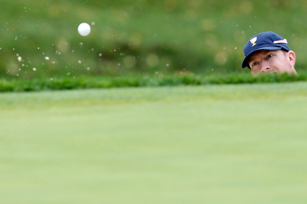 . United States team player Hunter Mahan hits out of a bunker on the  second hole during the single matches at the Presidents Cup golf tournament at Muirfield Village Golf Club Sunday, Oct. 6, 2013, in Dublin, Ohio. (AP Photo/Jay LaPrete)