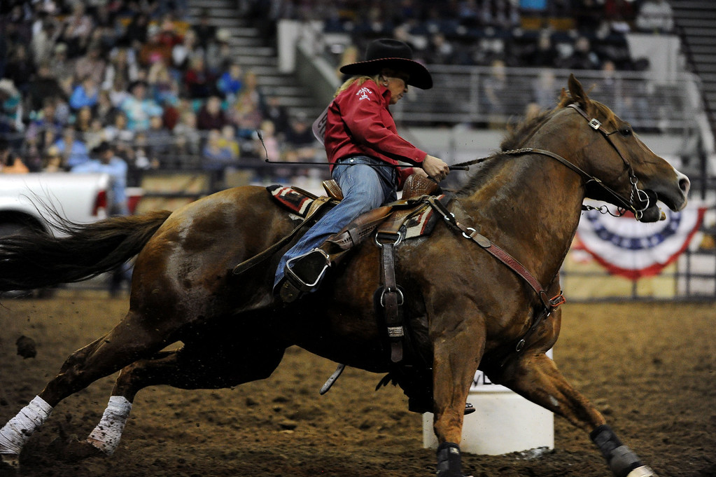 . DENVER, CO- JANUARY 27:  Benette Little, of Ardmore, Oklahoma, drives her horse past a barrel during the barrel race.  The final day of the 2013 National Western Stock show was Sunday, January 27th.  One of the big events for the day was the PRCA Pro Rodeo finals in the Coliseum.  The event featured bareback riding, steer wrestling, team roping, saddle bronc riding, tie down roping, barrel racing and bull riding.  (Photo By Helen H. Richardson/ The Denver Post)