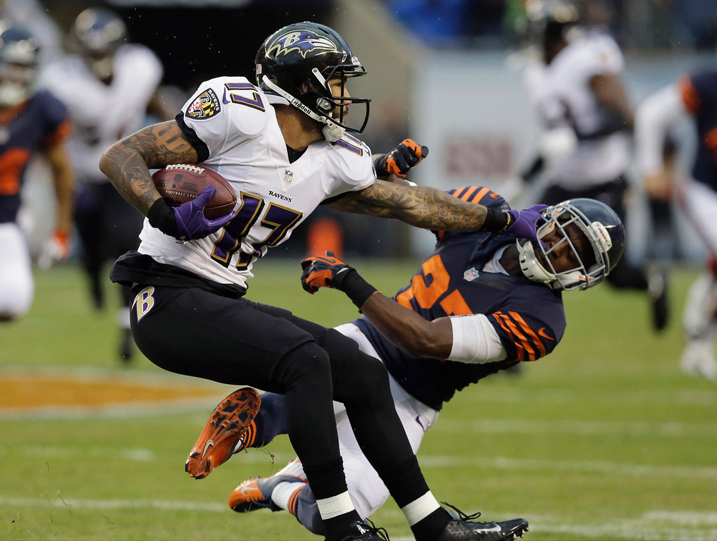 . Baltimore Ravens wide receiver Tandon Doss (17) pushes off Chicago Bears defensive back Sherrick McManis (27) during the first half of an NFL football game, Sunday, Nov. 17, 2013, in Chicago. (AP Photo/Nam Y. Huh)