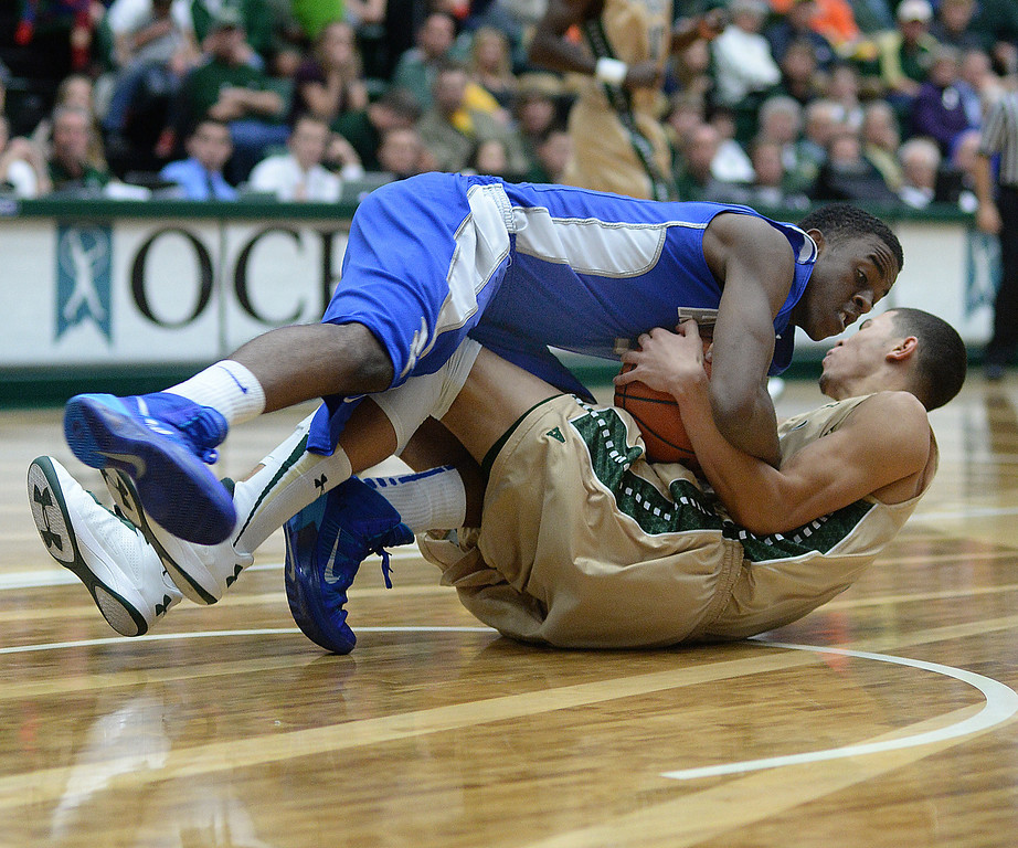 . FORT COLLINS, CO. - JANUARY 18:  Air Force junior forward Justin Hammonds, top, wrestled a rebound all the way to the court with CSU forward Marcus Holt, bottom, in the second half. The Colorado State men\'s basketball team defeated Air Force 74-68 at Moby Arena in Fort Collins Saturday night, January 18, 2014. Photo By Karl Gehring/The Denver Post