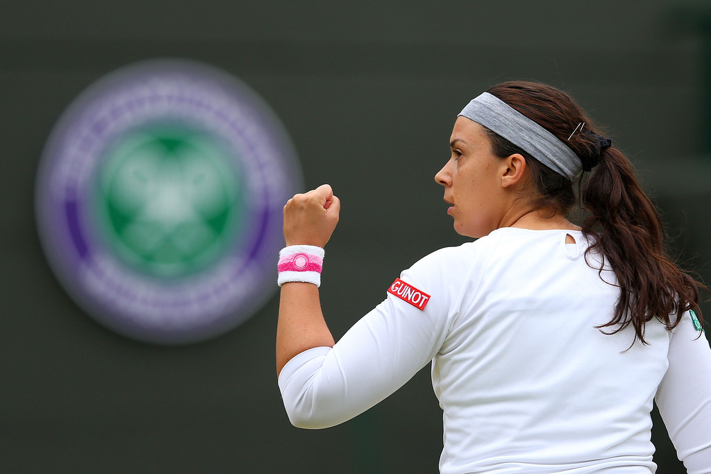 . LONDON, ENGLAND - JULY 02:  Marion Bartoli of France celebrates a point during the Ladies\' Singles quarter-final match against Sloane Stephens of United States of America on day eight of the Wimbledon Lawn Tennis Championships at the All England Lawn Tennis and Croquet Club at Wimbledon on July 2, 2013 in London, England.  (Photo by Julian Finney/Getty Images)