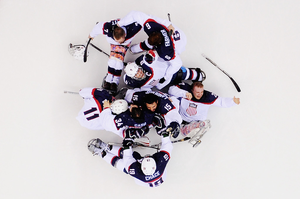 . The United States team celebrate winning the gold medal after the Ice Sledge Hockey Gold Medal game between the United States and Russia on day eight of the Sochi 2014 Paralympic Winter Games at Shayba Arena on March 15, 2014 in Sochi, Russia.  (Photo by Dennis Grombkowski/Getty Images)