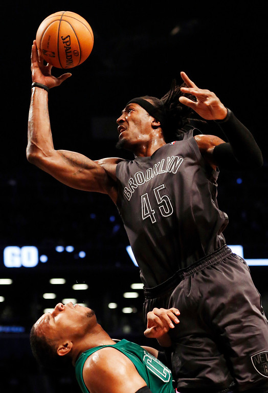. Brooklyn Nets forward Gerald Wallace (45) fouls Boston Celtics forward Jared Sullinger (7) while shooting in the first half of their NBA basketball game at Barclays Center, Tuesday, Dec. 25, 2012, in New York. (AP Photo/John Minchillo)
