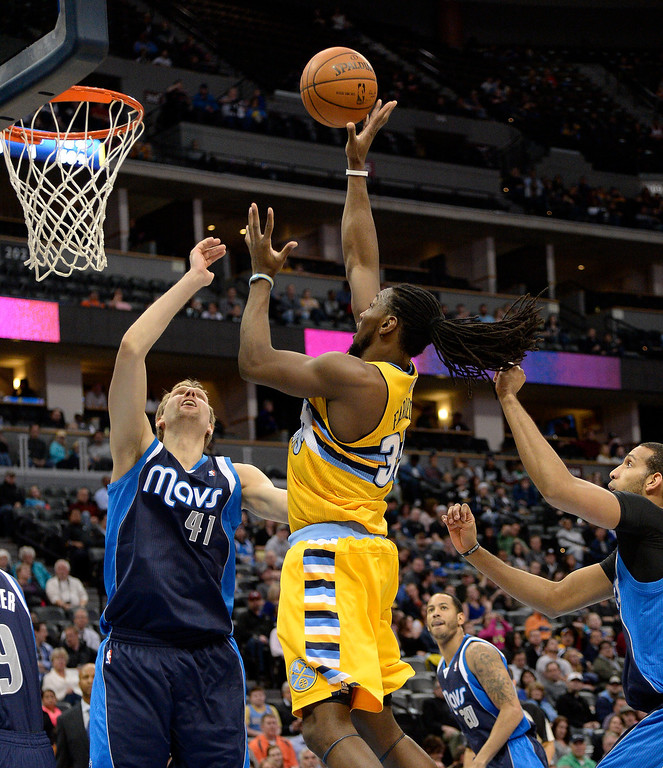 . Denver Nuggets power forward Kenneth Faried (35) goes up for a shot over Dallas Mavericks power forward Dirk Nowitzki (41) during the first quarter March 5, 2014 at Pepsi Center. (Photo by John Leyba/The Denver Post)