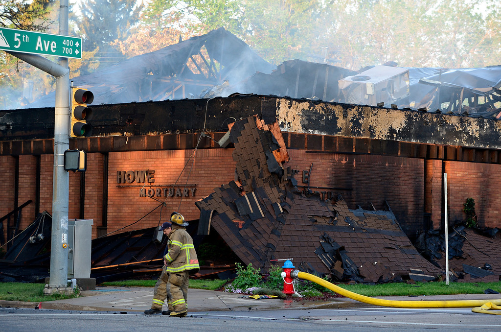 . Howe Mortuary continues to smolder Tuesday morning, May 28, 2013, after an overnight fire that caused the roof to collapse. (Greg Lindstrom/Times-Call)