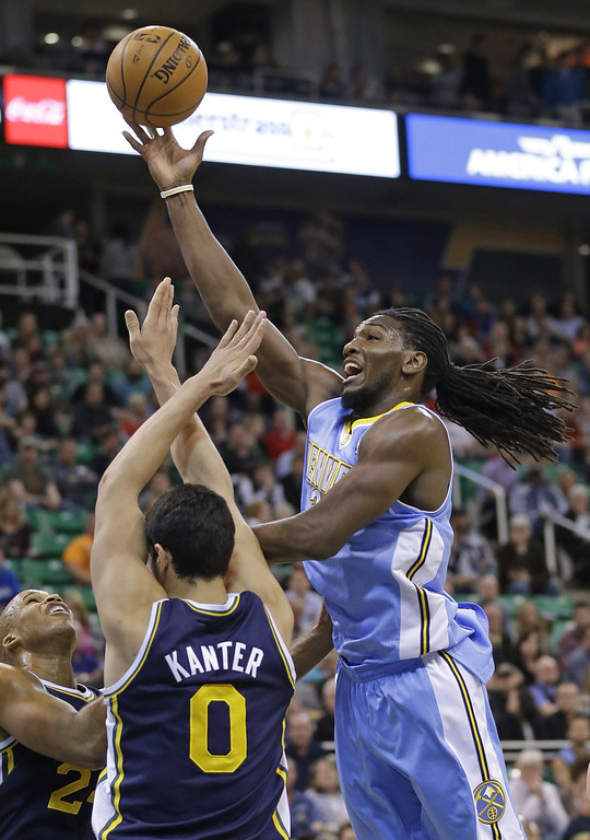 . Denver Nuggets\' Kenneth Faried, right, lays the ball up as Utah Jazz\'s Richard Jefferson, left, and teammate Enes Kanter (0), of Turkey, defend in the first quarter during an NBA basketball game Monday, Nov. 11, 2013, in Salt Lake City.  (AP Photo/Rick Bowmer)