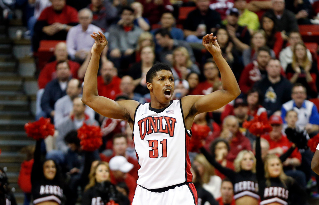 . UNLV\'s Justin Hawkins celebrates a score during the second half of an NCAA college basketball game against Colorado State on Wednesday, Feb. 20, 2013, in Las Vegas. UNLV defeated Colorado State 61-59. (AP Photo/Isaac Brekken)