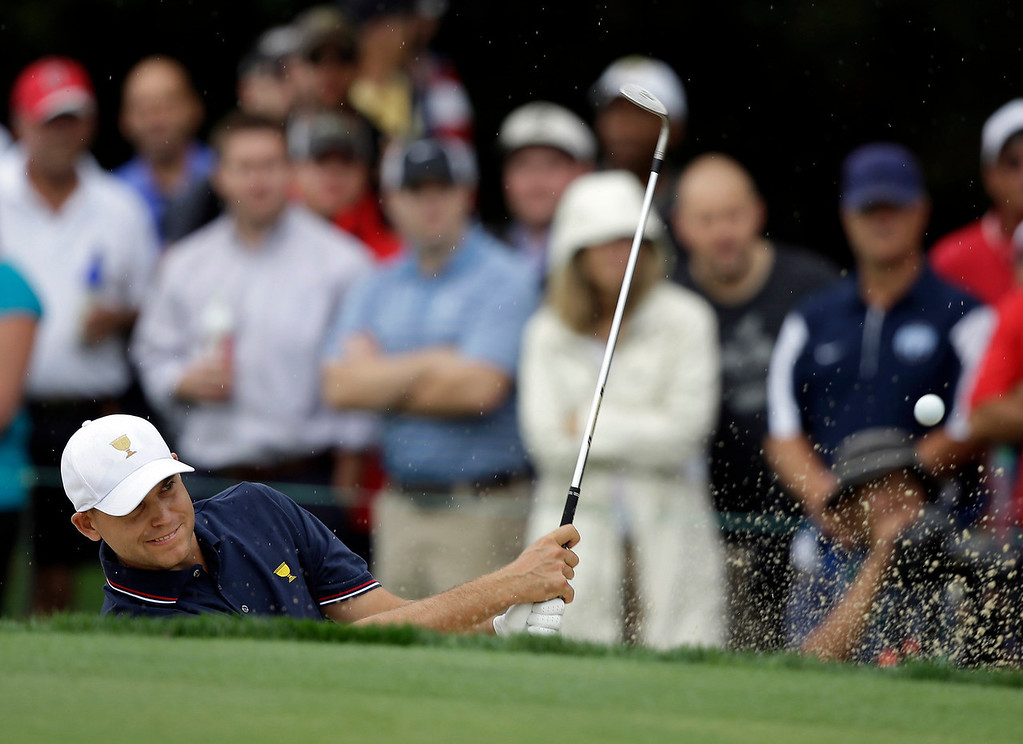 . United States team player Bill Haas hits out of the bunker on the second hole during a four-ball match against the International team at the Presidents Cup golf tournament at Muirfield Village Golf Club Thursday, Oct. 3, 2013, in Dublin, Ohio. (AP Photo/Darron Cummings)